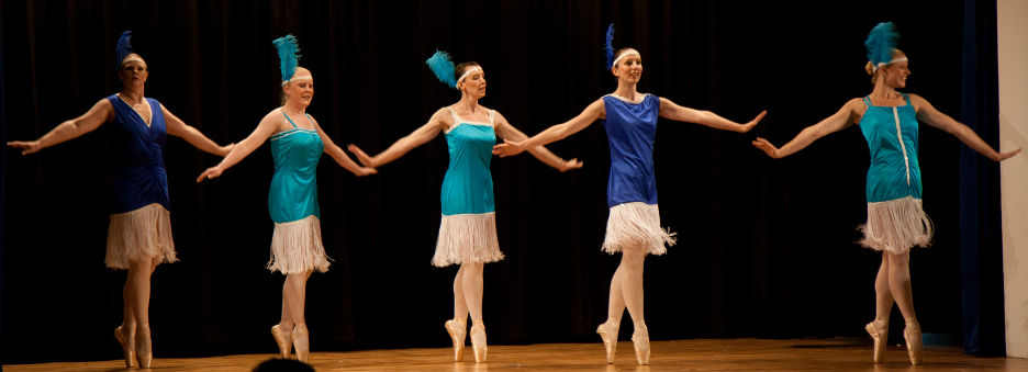 Adult pointe class on stage