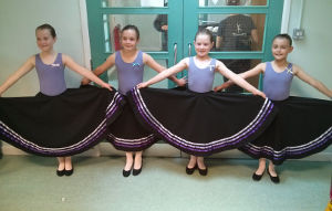 Grade 1 students in Character Skirts ready for their exam